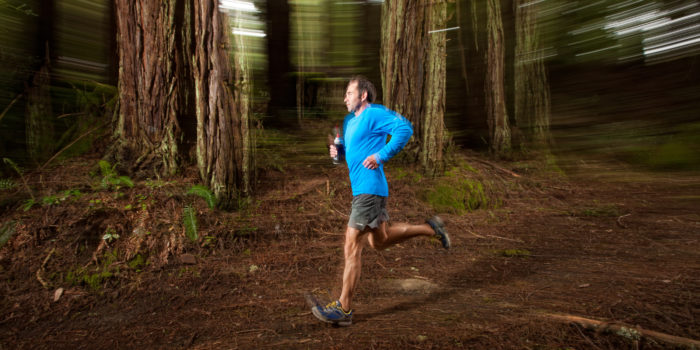 Man Trail Running In Redwoods